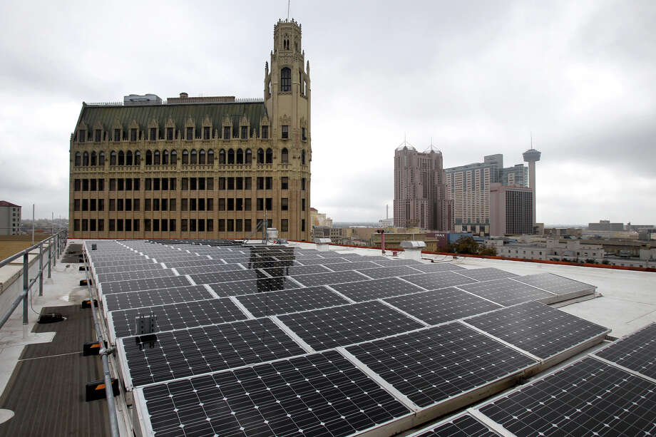 "Solar panels on the roof of the Hipolito F. Garcia Federal Building are one of the most notable of the building's many new sustainability features. Other features include an electric refueling station, bike racks, a vegetated ""green"" roof, window improvements and more. Photo: JOHN DAVENPORT, STAFF / ©San Antonio Express-News/Photo Can Be Sold to the Public"