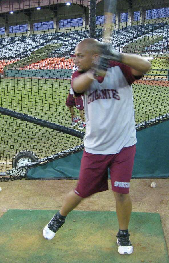 Astros catcher Carlos Corporan takes batting practice in preparation for a Puerto Rican winter league game.