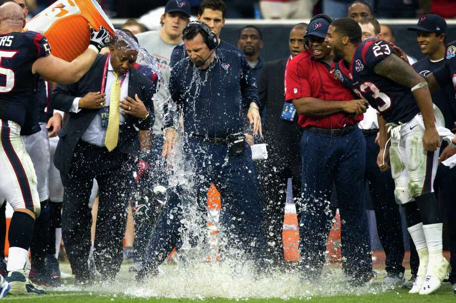 Houston Texans head coach Gary Kubiak has water splashed over him at the end the Texans victory over the Indianapolis Colts to win the AFC South for the second straight year. Photo: Brett Coomer, Houston Chronicle / © 2012  Houston Chronicle