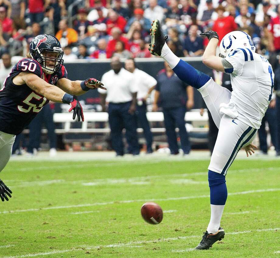 Texans linebacker Bryan Braman blocks a punt by Indianapolis punter Pat McAfee during the second quarter. Braman recovered in the end zone for a touchdown. Photo: Brett Coomer, Houston Chronicle / © 2012  Houston Chronicle
