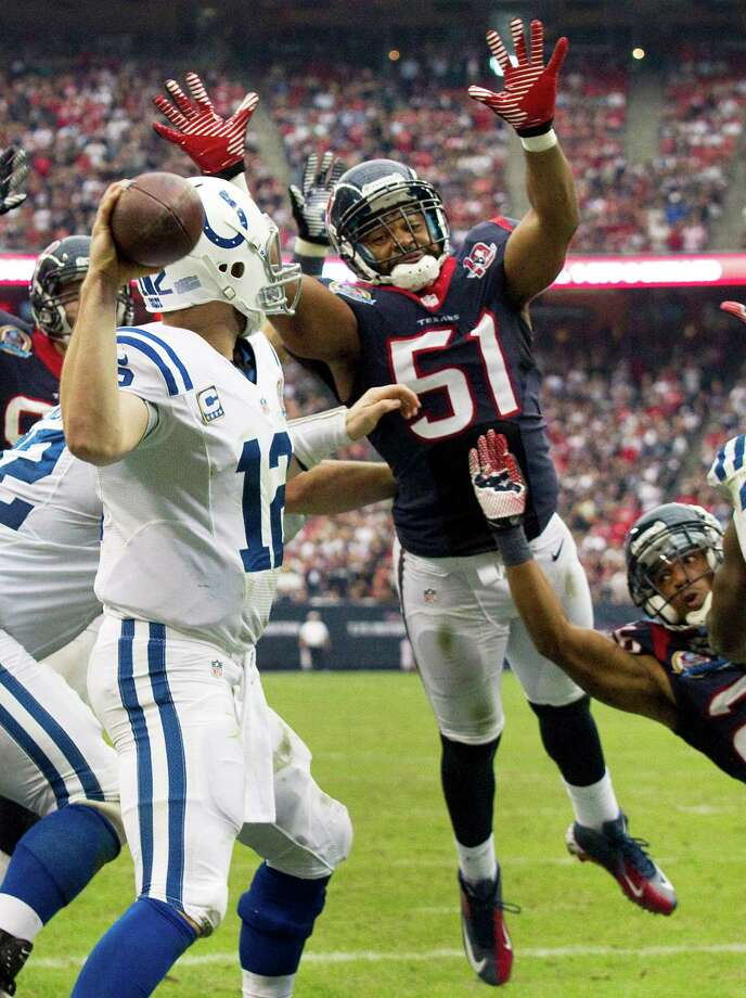 Texans inside linebacker Darryl Sharpton (51) leaps toward Colts quarterback Andrew Luck (12) to defend a pass during the fourth quarter. Photo: Brett Coomer, Houston Chronicle / © 2012  Houston Chronicle