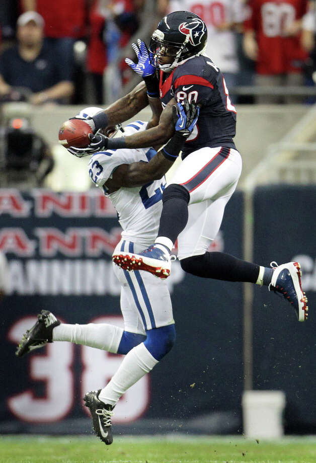 Texans wide receiver Andre Johnson makes a midfield catch as Colts cornerback Vontae Davis (23) tries to defend during the first quarter. Photo: Karen Warren, Houston Chronicle / © 2012 Houston Chronicle