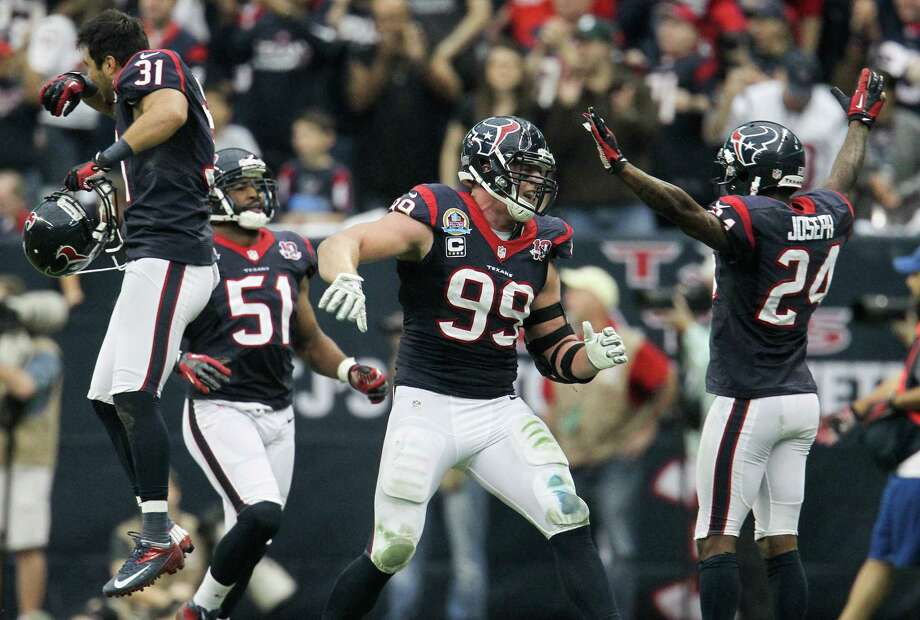 Texans defensive end J.J. Watt (99) celebrates with cornerback Johnathan Joseph (24), inside linebacker Darryl Sharpton (51) and defensive back Shiloh Keo (31) after a turnover during the second quarter. Photo: Karen Warren, Houston Chronicle / © 2012 Houston Chronicle