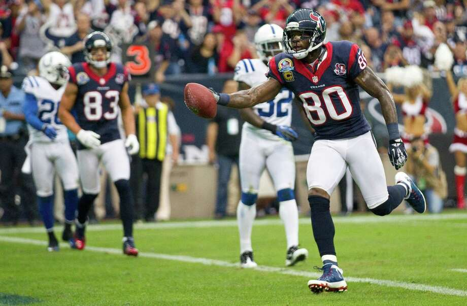 Texans wide receiver Andre Johnson scores on a first quarter touchdown reception. Photo: Brett Coomer, Houston Chronicle / © 2012  Houston Chronicle
