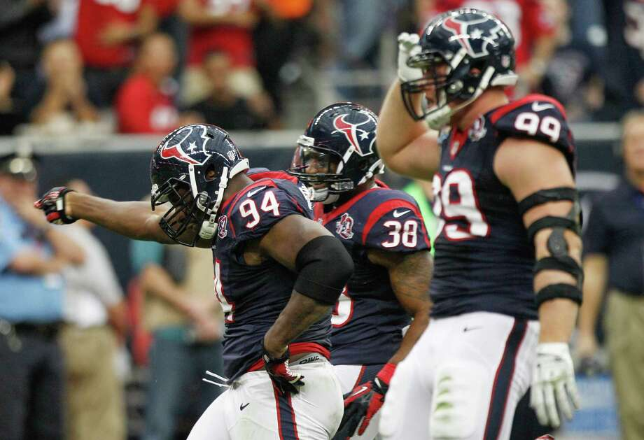 Texans defensive end Antonio Smith (94) and defensive end J.J. Watt (99) celebrate a sack of Colts quarterback Andrew Luck during the first quarter. Photo: Brett Coomer, Houston Chronicle / © 2012  Houston Chronicle