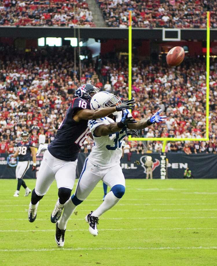 Colts cornerback Cassius Vaughn (32) breaks up a pass intended for Texans wide receiver Lestar Jean (18) during the first quarter. Photo: Smiley N. Pool, Houston Chronicle / © 2012  Houston Chronicle