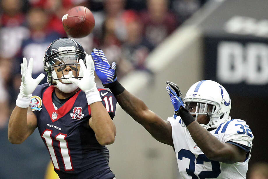 Texans wide receiver DeVier Posey (11) makes a first down catch as Colts cornerback Cassius Vaughn (32) tries to defend during the second quarter. Photo: Nick De La Torre, Houston Chronicle / © 2012  Houston Chronicle