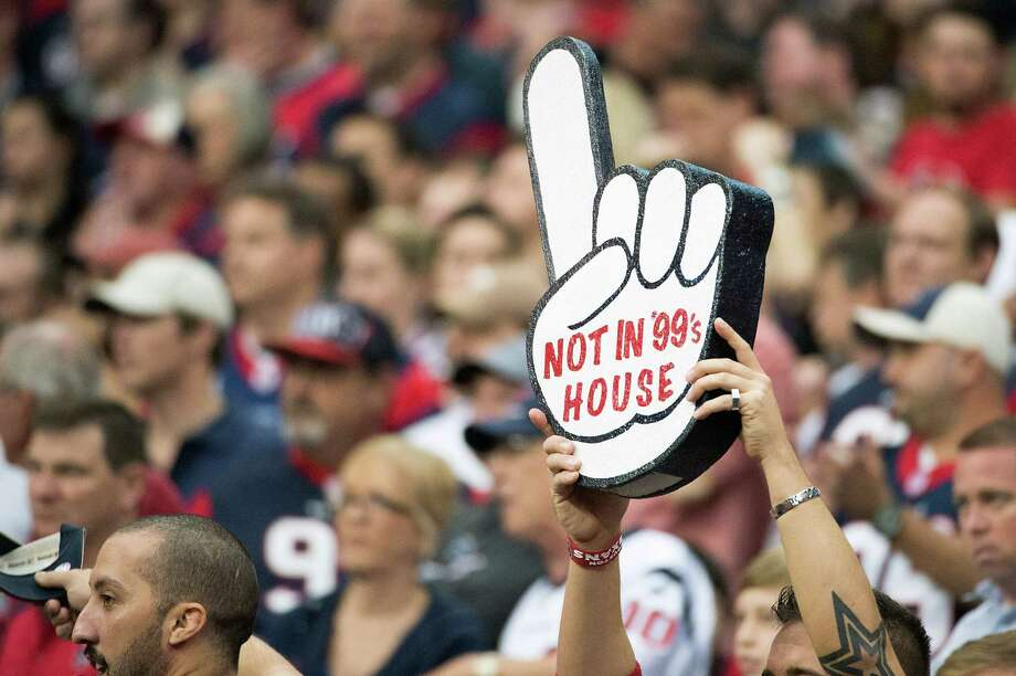 A Texans fan holds up a sign in support of defensive end J.J. Watt during the third quarter. Photo: Smiley N. Pool, Houston Chronicle / © 2012  Houston Chronicle