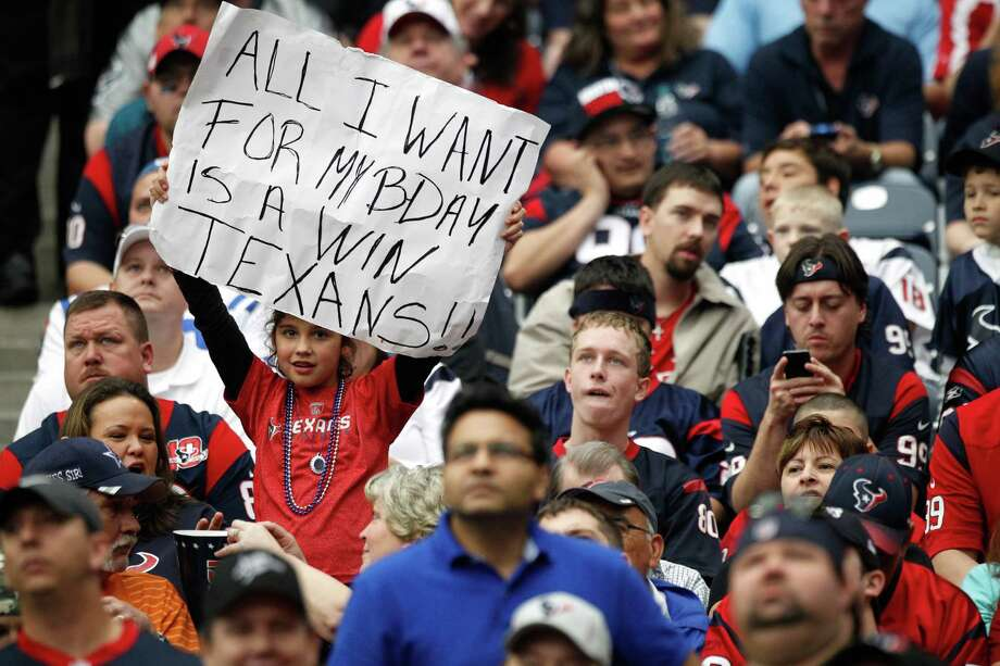 A Texans fan holds up a sign wishing for a win for her birthday during the third quarter. Photo: Brett Coomer, Houston Chronicle / © 2012  Houston Chronicle