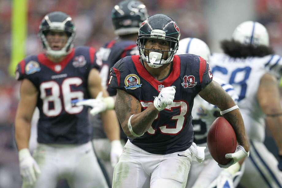 Texans running back Arian Foster finds running room during the fourth quarter. Photo: Karen Warren, Houston Chronicle / © 2012 Houston Chronicle