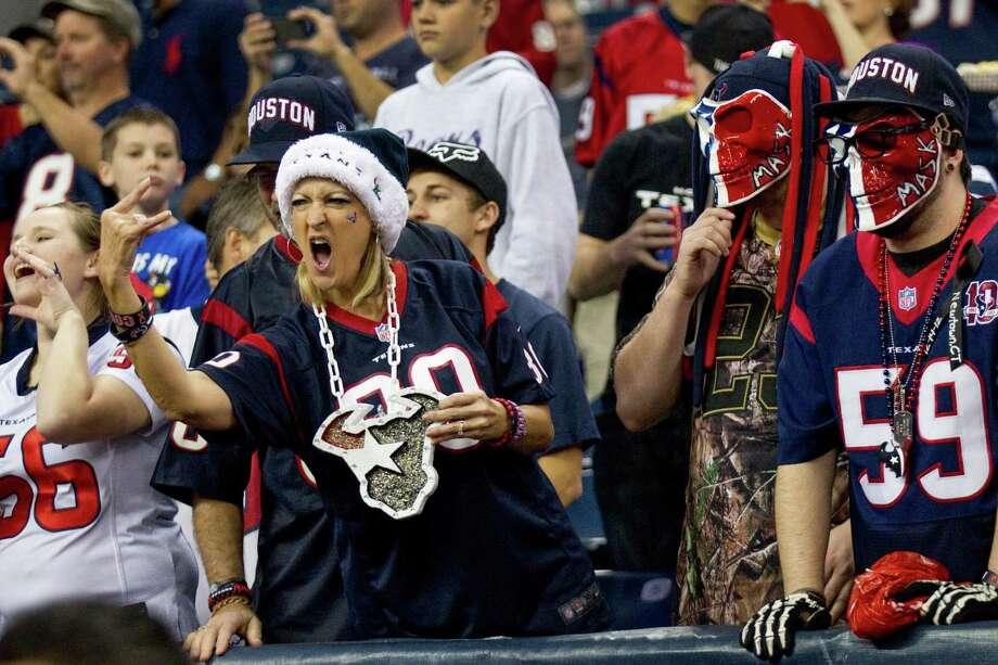 Texans fans cheer before the game. Photo: Brett Coomer, Houston Chronicle / © 2012  Houston Chronicle