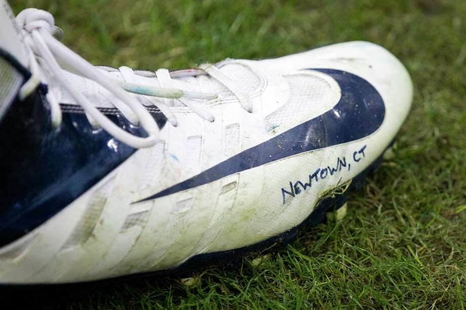 Texans defensive end J.J. Watt's cleat has a tribute to the victims of the Newtown, Conn., school shooting. Photo: Brett Coomer, Houston Chronicle / © 2012  Houston Chronicle