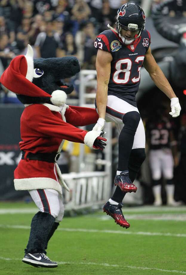 Houston Texans mascot Toro greets wide receiver Kevin Walter as the offense is introduced before the game. Photo: Karen Warren, Houston Chronicle / © 2012 Houston Chronicle