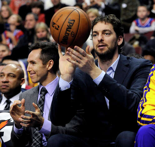 Los Angeles Lakers' Steve Nash, left, claps while Pau Gasol throws back a ball that went out of bounds during the second half of an NBA basketball game against the Philadelphia 76ers, Sunday, Dec. 16, 2012, in Philadelphia. The Lakers won 111-98. (AP Photo/Michael Perez) Photo: Michael Perez