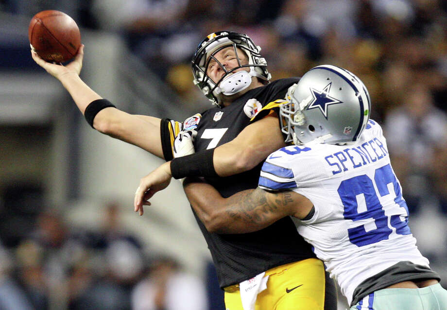 Pittsburgh Steelers' quarterback Ben Roethlisberger is able to get rid of the ball as he is hit by Dallas Cowboys' defensive tackle Anthony Spencer during the second half at Cowboys Stadium in Arlington, Texas, Sunday, Dec. 16, 2012. The Cowboys won 27-24 in overtime. Photo: Jerry Lara, San Antonio Express-News / © 2012 San Antonio Express-News