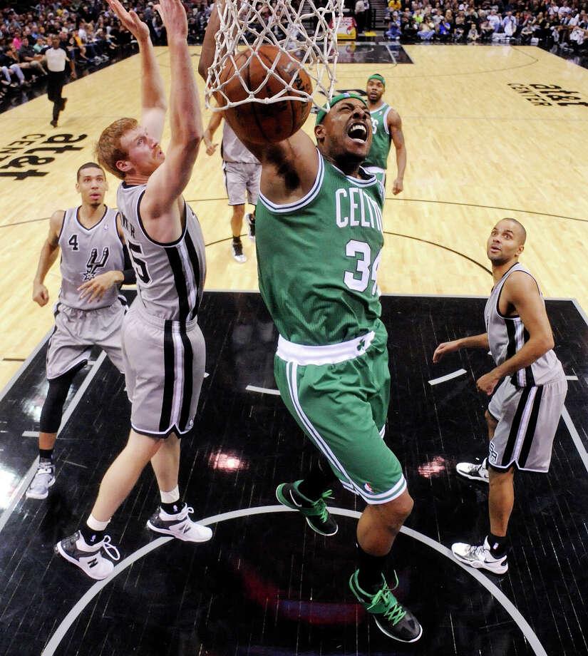 Boston Celtics' Paul Pierce reacts after a dunk against the San Antonio Spurs' Matt Bonner during first half action Saturday Dec. 15, 2012 at the AT&T Center. The Spurs won 103-88. Photo: Edward A. Ornelas, San Antonio Express-News / © 2012 San Antonio Express-News