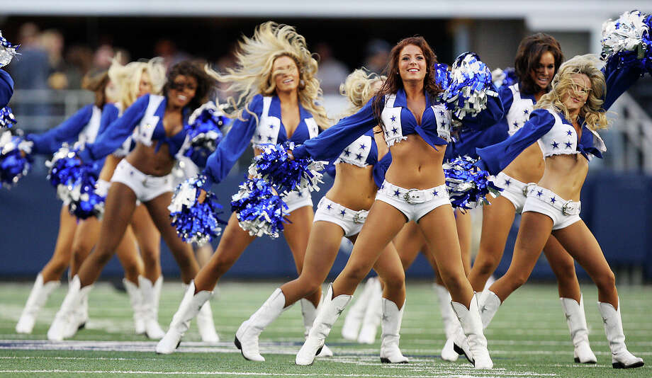 The Dallas Cowboys cheerleaders perform before their game against the Pittsburgh Steelers at Cowboys Stadium in Arlington, Texas, Sunday, Dec. 16, 2012. Photo: Jerry Lara, Express-News / © 2012 San Antonio Express-News