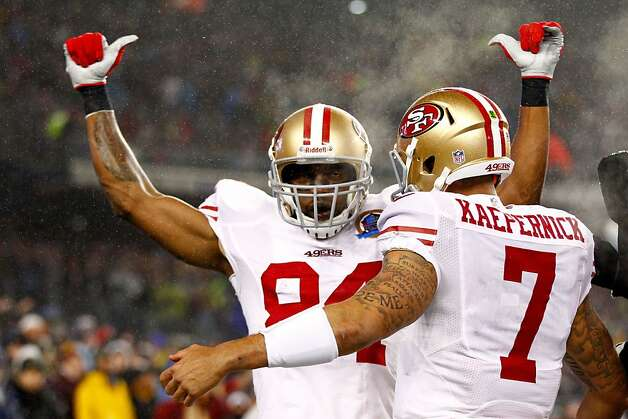 49ers wide receiver Randy Moss, left, celebrates with quarterback Colin Kaepernick  after scoring a touchdown in the first quarter against the Patriots at Gillette Stadium on December 16, 2012 in Foxboro, Mass. Photo: Jared Wickerham, Getty Images