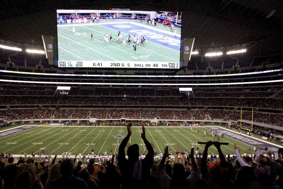 Pearland fans celebrate after a score during the third quarter against the Euless Trinity Trojans in the Class 5A, Division I state championship game at Cowboys  Stadium on Saturday, Dec. 18, 2010, in Arlington.  ( Smiley N. Pool / Houston Chronicle ) Photo: Smiley N. Pool, Staff / Houston Chronicle