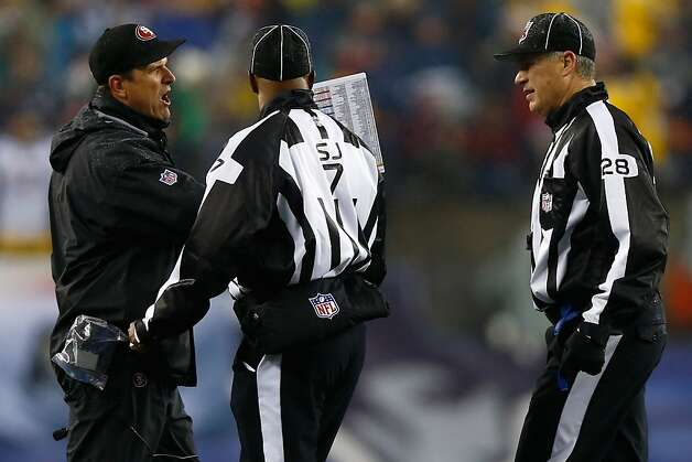 FOXBORO, MA - DECEMBER 16:  head coach Jim Harbaugh of the San Francisco 49ers argues with side judge Keith Washington #7 and head linesman Mark Hittner #28 against the New England Patriots at Gillette Stadium on December 16, 2012 in Foxboro, Massachusetts.  (Photo by Jared Wickerham/Getty Images) Photo: Jared Wickerham, Getty Images