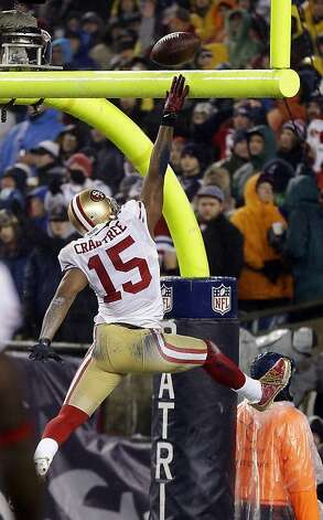 San Francisco 49ers wide receiver Michael Crabtree (15) spikes the ball over the goal post after scoring a touchdown against the New England Patriots in the third quarter of an NFL football game in Foxborough, Mass., Sunday, Dec. 16, 2012. (AP Photo/Elise Amendola) Photo: Elise Amendola, Associated Press
