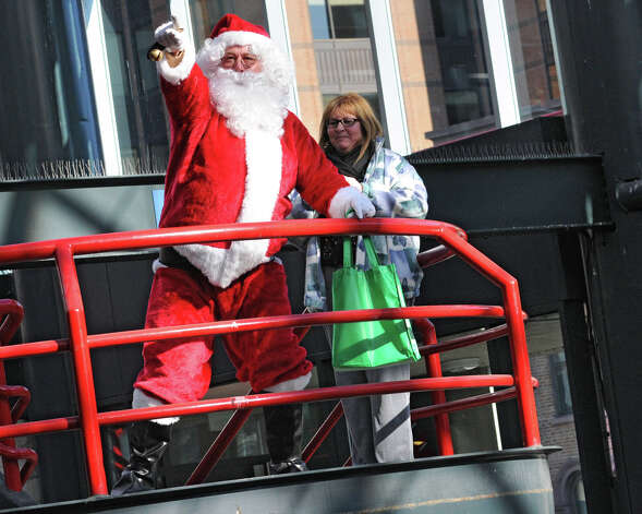 Santa Claus gets a crowd of people going participating in setting the world record for being the largest group singing jingle bells while ringing jingle bells for recordsetter.com in front of the Times Union Center on Wednesday Dec. 12, 2012 at 12 Noon in Albany, N.Y.  (Lori Van Buren / Times Union) Photo: Lori Van Buren / 00020449A