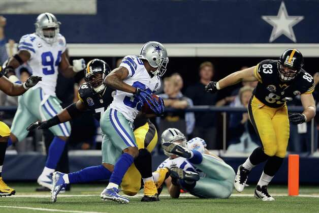 Brandon Carr #39 of the Dallas Cowboys runs after making a pass interception in overtime against the Pittsburgh Steelers at Cowboys Stadium on December 16, 2012 in Arlington, Texas. Photo: Ronald Martinez, Getty Images / 2012 Getty Images