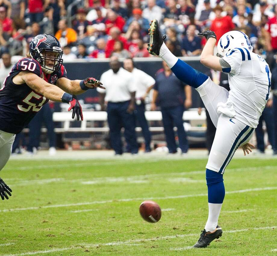 Texans linebacker Bryan Braman blocks a punt by Indianapolis punter Pat McAfee during the second quarter. Braman recovered in the end zone for a touchdown. (Brett Coomer / Houston Chronicle)
