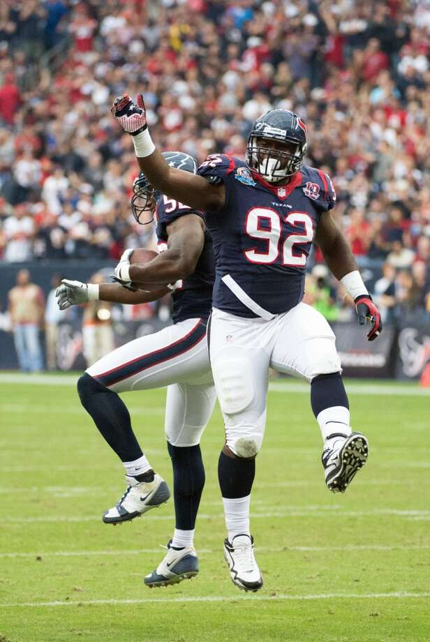 Texans nose tackle Earl Mitchell (92) celebrates with linebacker Tim Dobbins (52) after Dobbins recovered a fumble during the first quarter. (Smiley N. Pool / Houston Chronicle)