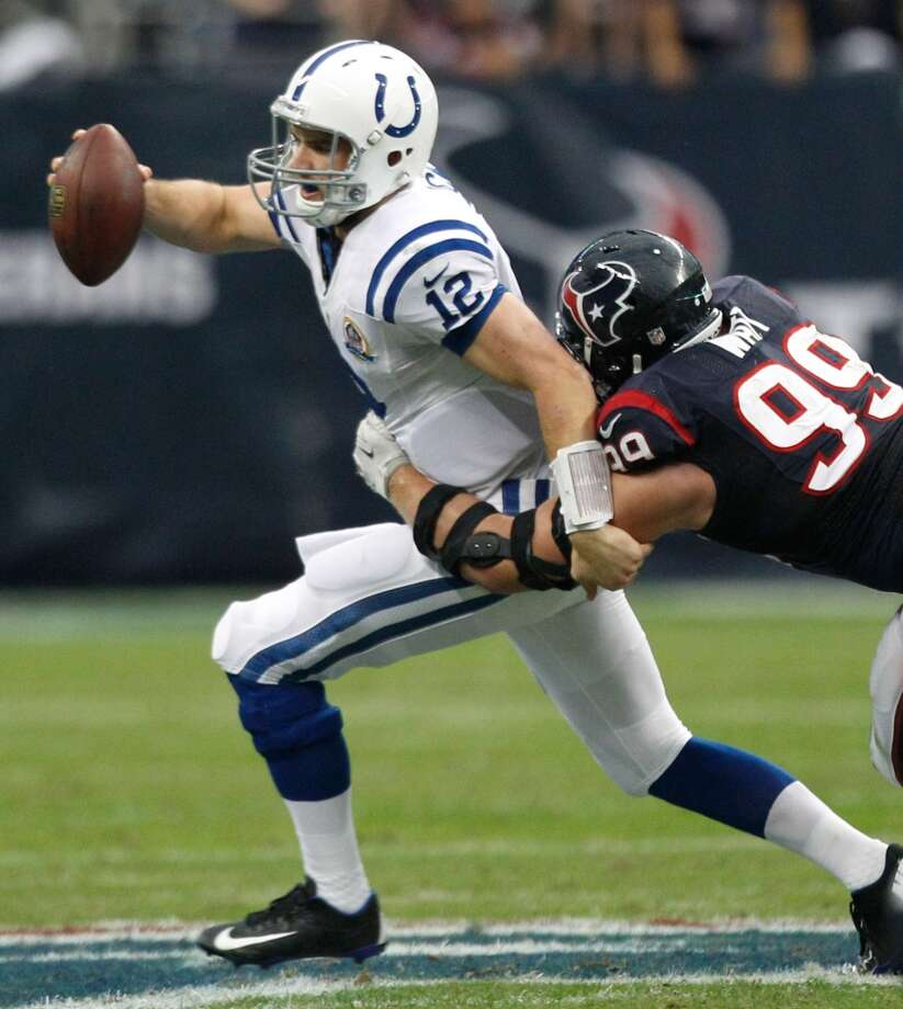 Texans defensive end J.J. Watt (99) sacks Colts quarterback Andrew Luck (12) during the first quarter. (Brett Coomer / Houston Chronicle)