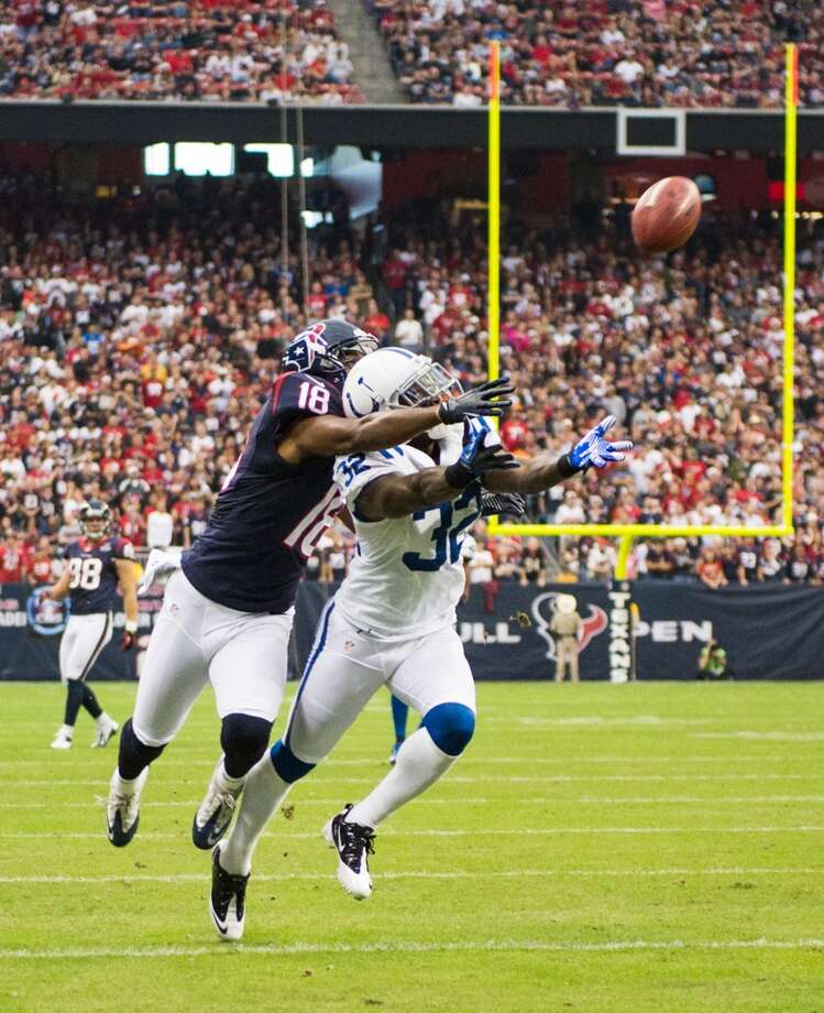 Colts cornerback Cassius Vaughn (32) breaks up a pass intended for Texans wide receiver Lestar Jean (18) during the first quarter. (Smiley N. Pool / Houston Chronicle)