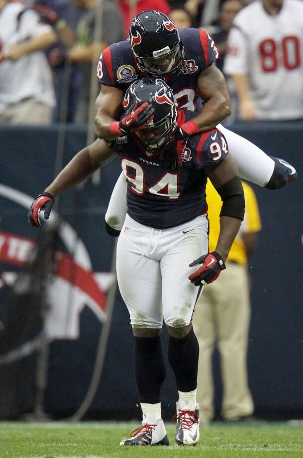 Texans free safety Danieal Manning (38) celebrates with defensive end Antonio Smith (94) after Smith sacked Colts quarterback Andrew Luck during the first quarter. (Karen Warren / Houston Chronicle)