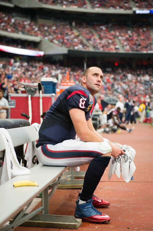 Texans quarterback Matt Schaub looks up a the scoreboard as he sits on the bench during the third quarter. (Smiley N. Pool / Houston Chronicle)