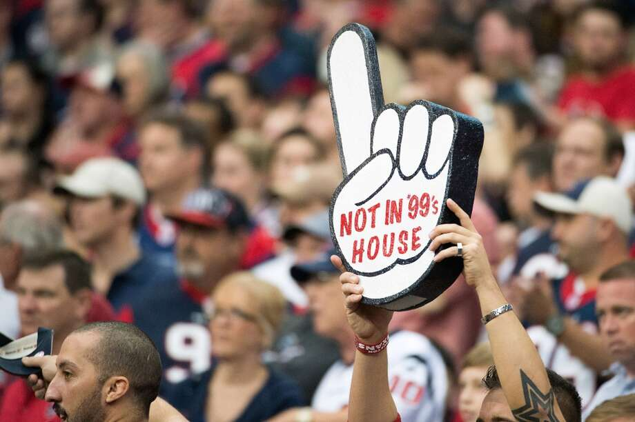 A Texans fan holds up a sign in support of defensive end J.J. Watt during the third quarter. (Smiley N. Pool / Houston Chronicle)