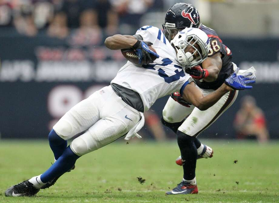 Texans free safety Danieal Manning (38) brings down Colts wide receiver T.Y. Hilton (13) during the third quarter. (Karen Warren / Houston Chronicle)
