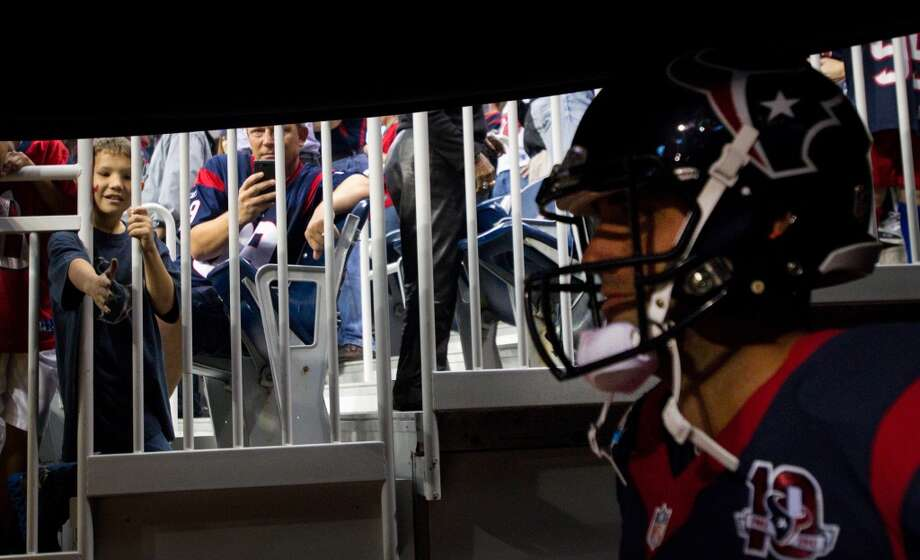 Texans fans look through a railing to see quarterback Matt Schaub as he waits to be introduced before the Texans game against the Indianapolis Colts at Reliant Stadium. (Brett Coomer / Houston Chronicle)