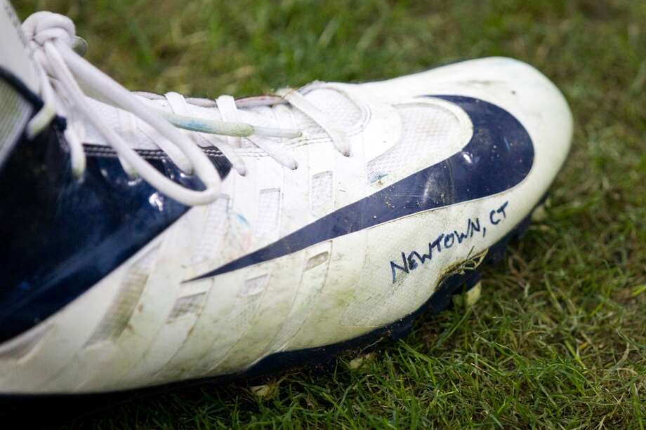 Texans defensive end J.J. Watt's cleat has a tribute to the victims of the Newtown, Conn., school shooting. (Brett Coomer / Houston Chronicle)