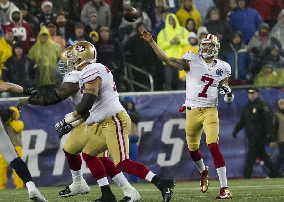 49ers quarterback Colin Kaepernick passes in the fourth quarter against the Patriots in their game at Gillette Stadium on Dec. 16, 2012. The 49ers won, 41-34. Photo: Kelvin Ma, Special To The Chronicle