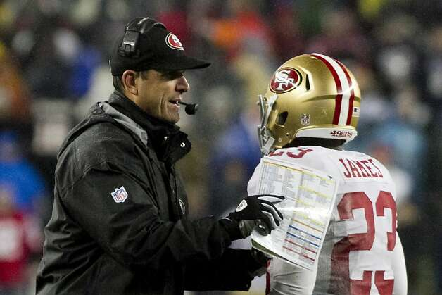 49ers head coach Jim Harbaugh pats running back LaMichael James on the shoulder after a run in the fourth quarter against the Patriots at Gillette Stadium on Dec. 16, 2012. The 49ers won, 41-34. Photo: Kelvin Ma, Special To The Chronicle