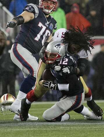 49ers defensive tackle Ray McDonald loses his helmet as he sacks Patriots quarterback Tom Brady in the fourth quarter of their game at Gillette Stadium on Dec. 16, 2012. The 49ers won, 41-34. Photo: Kelvin Ma, Special To The Chronicle