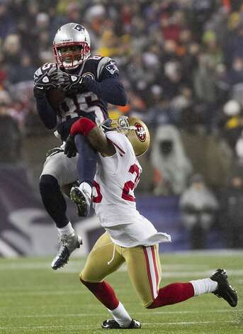 Patriots wide receiver Brandon Lloyd gets tackled by 49ers cornerback Tarell Brown in the second quarter of their game at Gillette Stadium on Dec. 16, 2012. Photo: Kelvin Ma, Special To The Chronicle