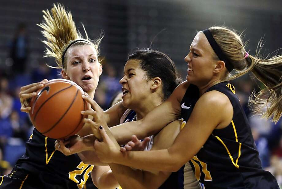 Drake forward Morgan Reid, center, fights for a rebound with Iowa guard Kali Peschel, left, and guard Trisha Nesbitt, right, during the first half of an NCAA college basketball game, Sunday, Dec. 16, 2012, in Des Moines, Iowa. (AP Photo/Charlie Neibergall) Photo: Charlie Neibergall, Associated Press