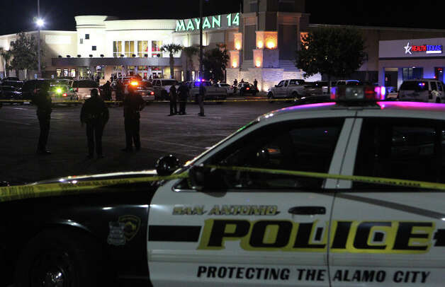 San Antonio Police stand guard near the Mayan 14 Theatres after an incident Sunday night, Dec. 16, 2012. Photo: JOHN DAVENPORT, San Antonio Express-News / San Antonio Express-News