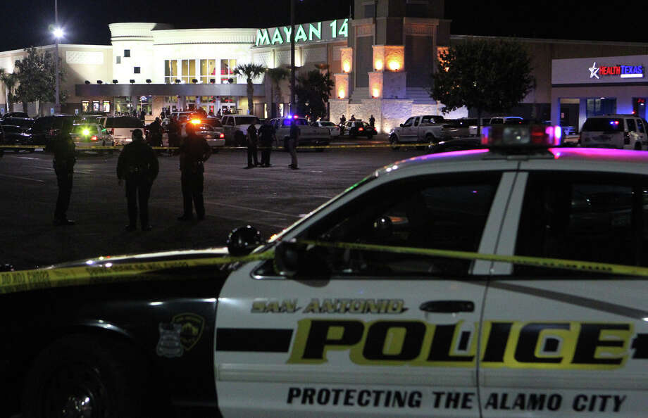 A recent breakup set off a shooting spree that ended with the suspect wounding a man at the Santikos Mayan Palace 14 movie theater Sunday night before being shot by an off-duty deputy, authorities said. Police are shown questioning men outside the theater Sunday night.. Jesus Manuel Garcia, 19, an employee at a nearby China Garden restaurant, apparently became upset Sunday night after his girlfriend broke up with him. Photo: JOHN DAVENPORT, San Antonio Express-News / San Antonio Express-News