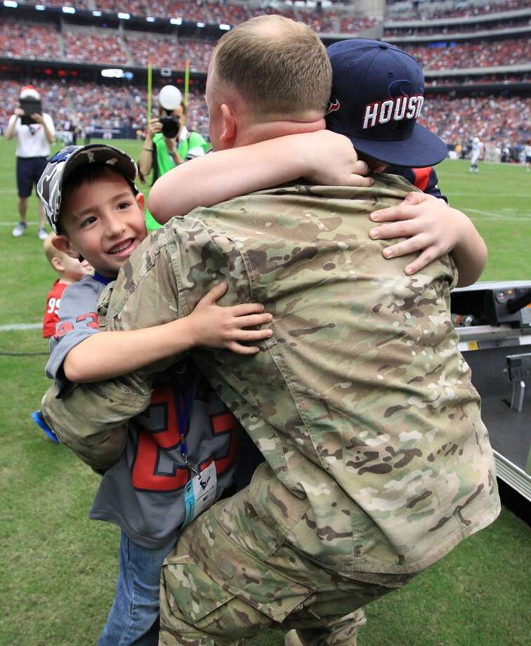 Army Chief Warrant Officer Eric Spoerle hugs his sons, Brandon, 6, left, and Tristin, 12. (Karen Warren / Chronicle)