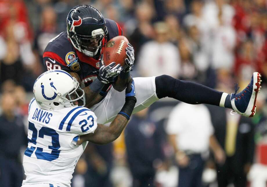 Texans wide receiver Andre Johnson makes a midfield catch over Colts cornerback Vontae Davis during the first quarter. (Brett Coomer / Houston Chronicle)