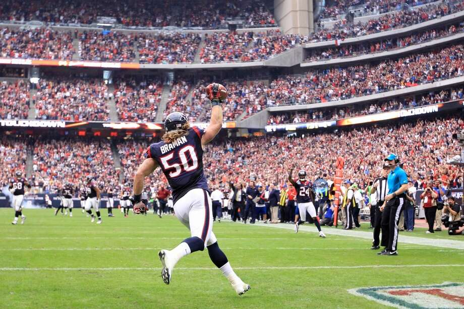 Texans linebacker Bryan Braman celebrates after scoring a  touchdown on his blocked punt during the second quarter. (Karen Warren / Houston Chronicle)