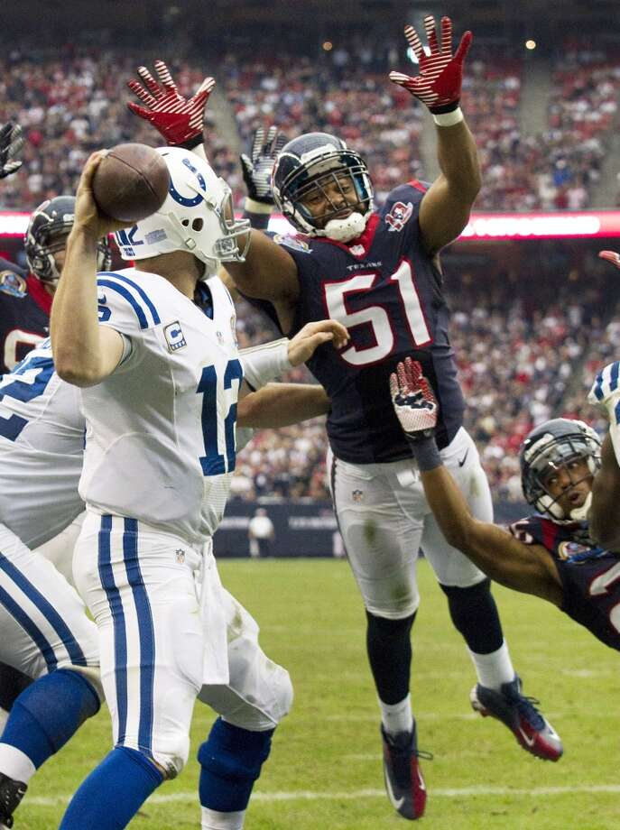 Texans inside linebacker Darryl Sharpton (51) leaps toward Colts quarterback Andrew Luck (12) to defend a pass during the fourth quarter. (Brett Coomer / Houston Chronicle)