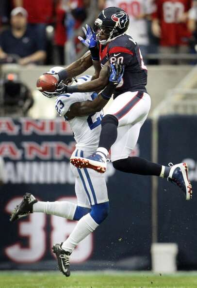 Texans wide receiver Andre Johnson makes a midfield catch as Colts cornerback Vontae Davis (23) trie