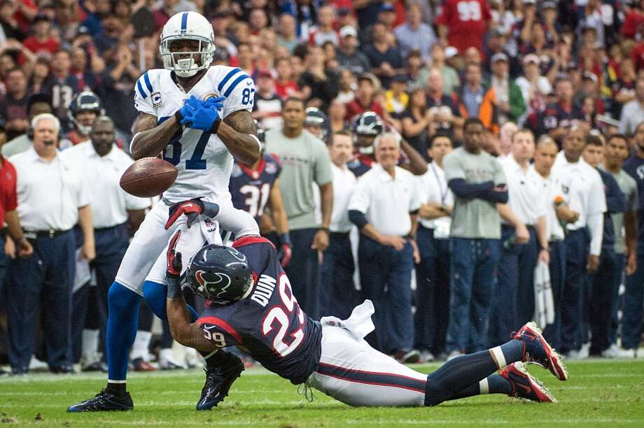 Texans strong safety Glover Quin (29) breaks up a pass intended for Colts wide receiver Reggie Wayne (87). (Smiley N. Pool / Houston Chronicle)